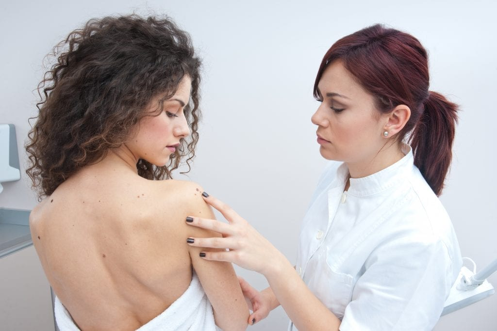 Dermatologist treating a patient in Bend, OR